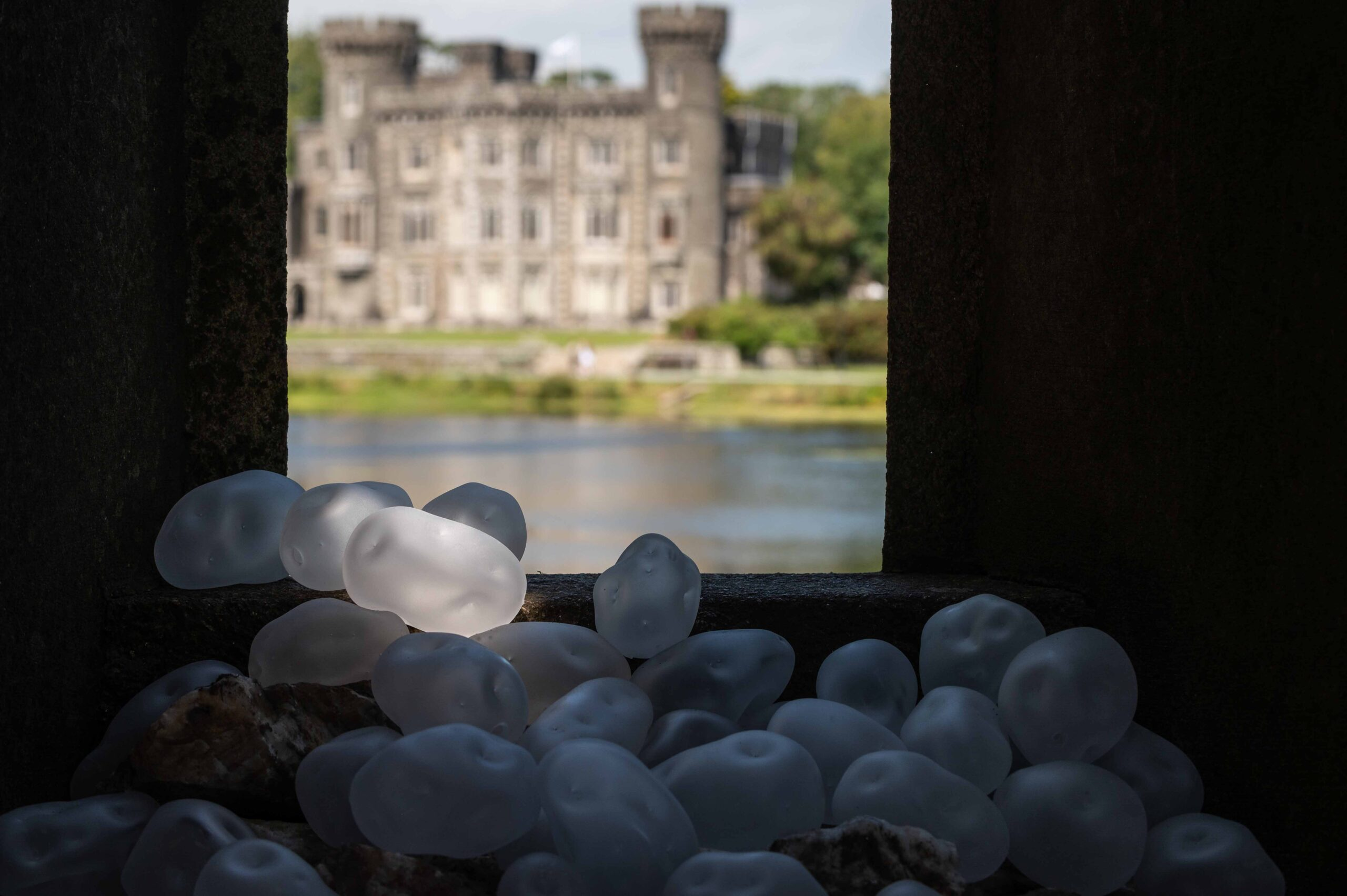 glass potatoes in tower overlooking lake and castle